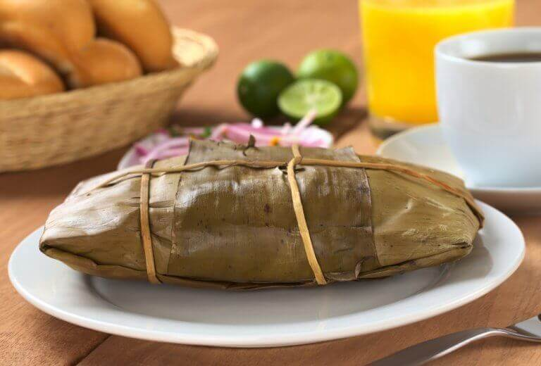 A tamal wrapped up in a leaf.