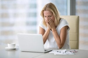 woman looking stressed in front of computer
