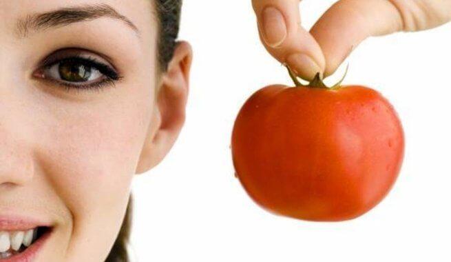 a woman holding a tomato