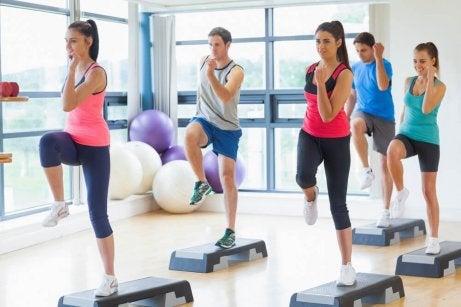 Knees to elbows during aerobics.