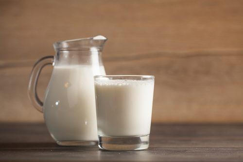 jug and glass of whole milk