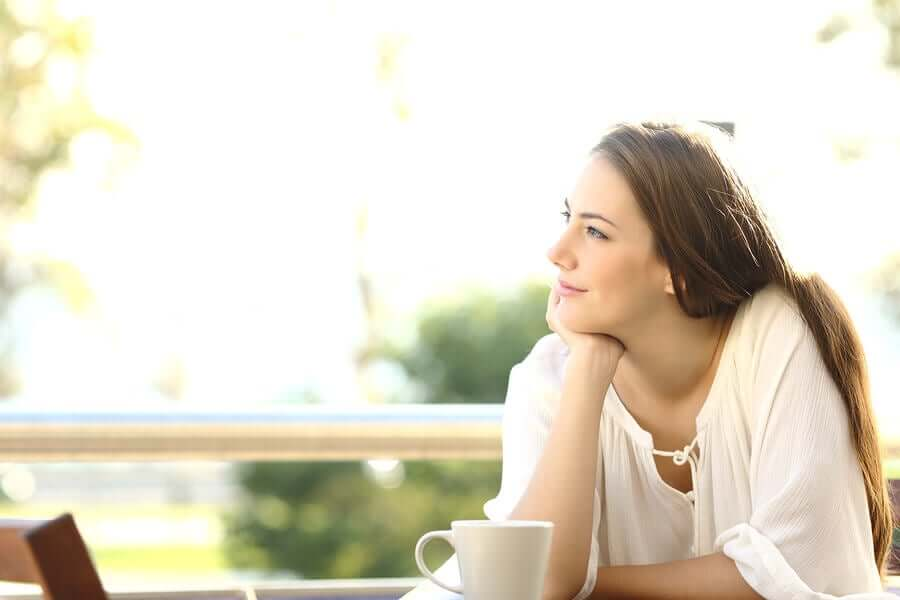 A woman thinking positive thoughts.