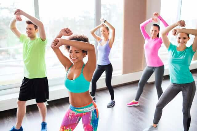 Adults dancing in a zumba class on the weekend.