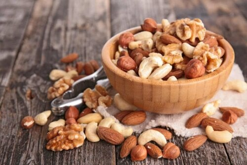 A bowl of nuts on a table.