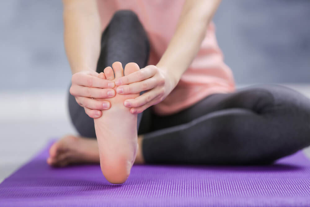 Person stretching their feet during yoga