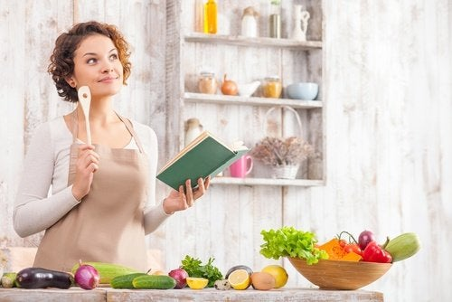 Woman planning menu with vegetables