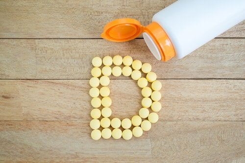 Vitamin D capsules forming the letter D.