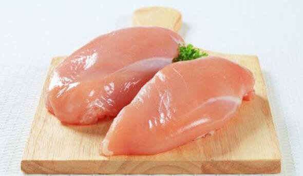 Chicken breasts on a chopping board