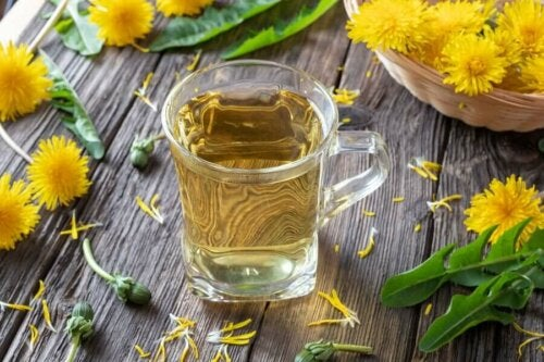 cup of dandelion tea with dandelion flowers all around