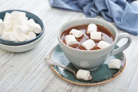 A cup of hot chocolate with marshmallows.