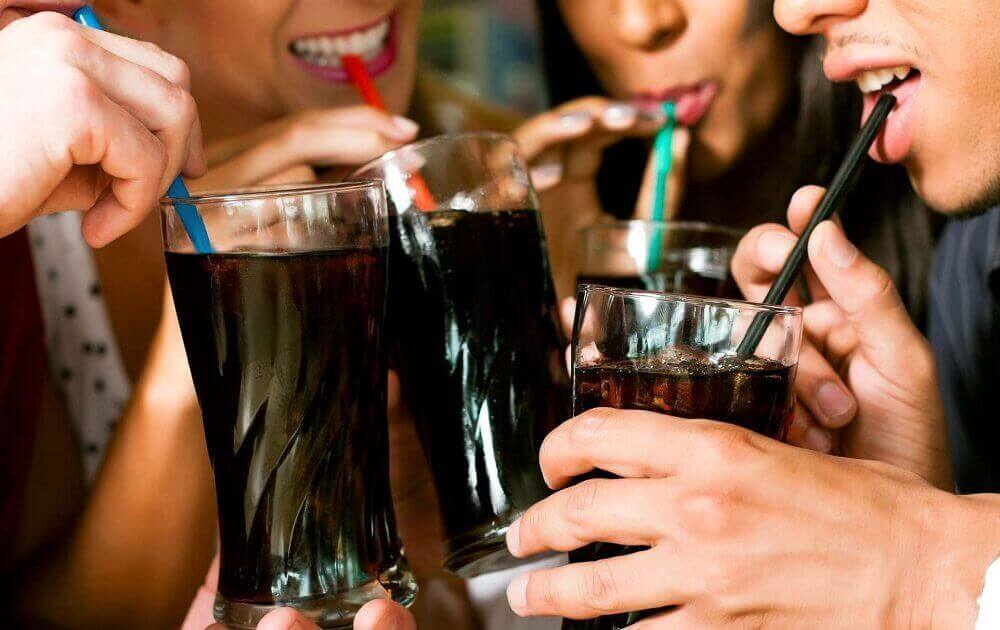 group of people drinking fizzy drinks