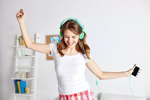 A girl dancing with headphones.