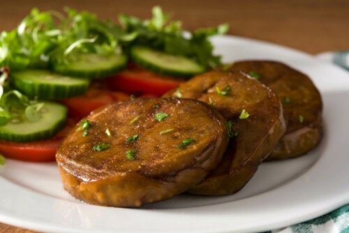 A dish of seitan steaks and vegetables.