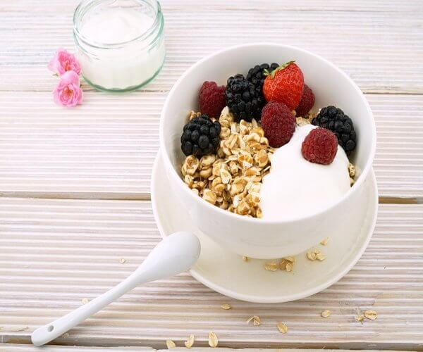 A probiotic breakfast with berries, granola, and yogurt