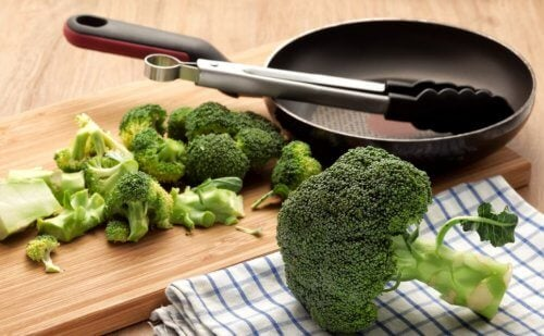Chopped broccoli next to a pan