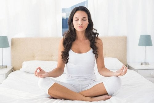 woman meditating yoga practices to manage stress