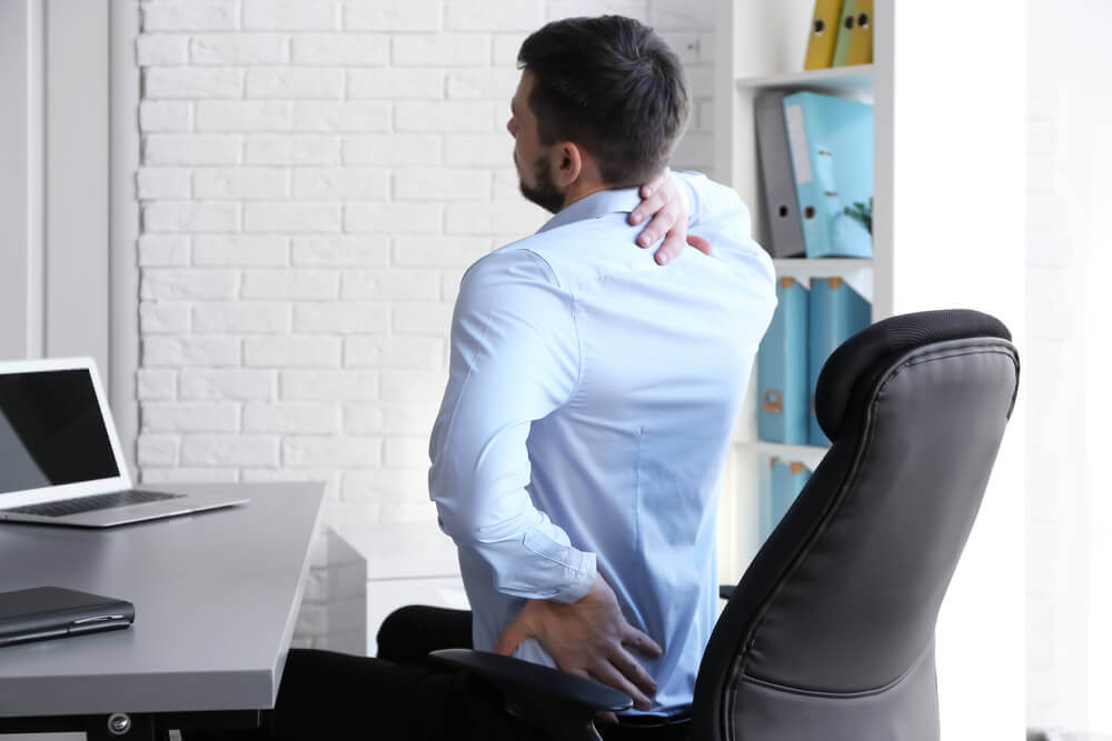 Man suffering from shoulder blade pain
