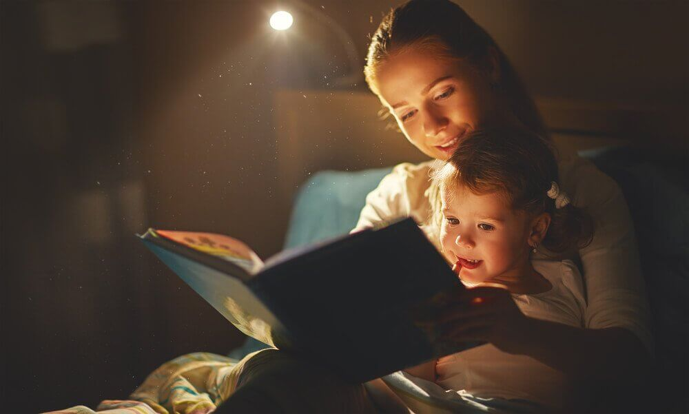 A mother reading to her child at bedtime.
