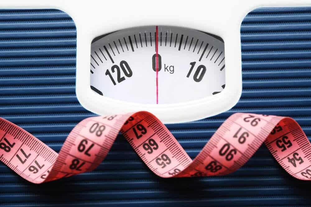 A weighing scale and measuring tape.