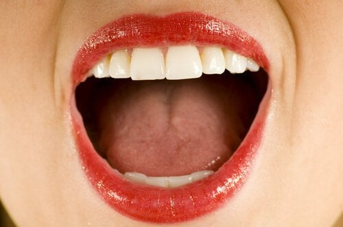 An open mouth with lipstick.