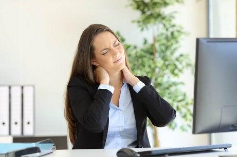 Woman suffering shoulder blade pain