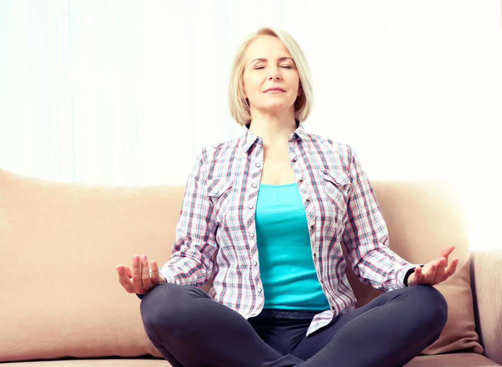 older woman meditating