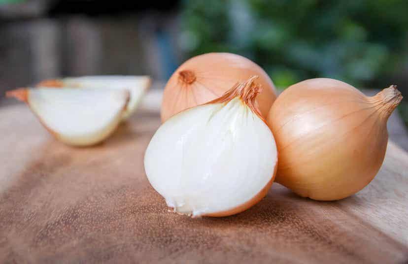 Onions on a cutting board.