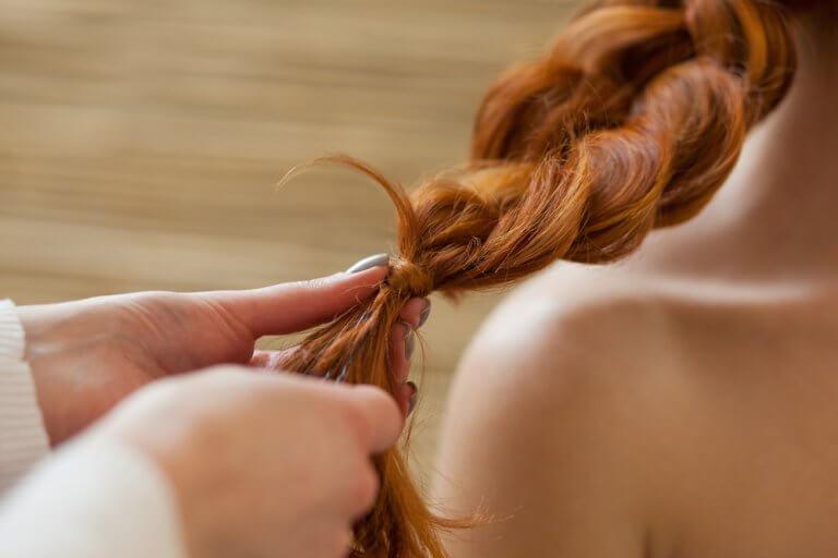 Red hair braided.