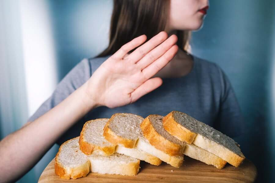 A woman saying no to bread.