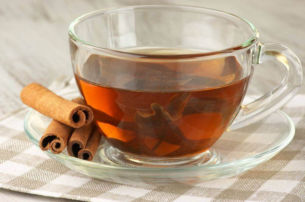 A cup of cinnamon and honey tea.