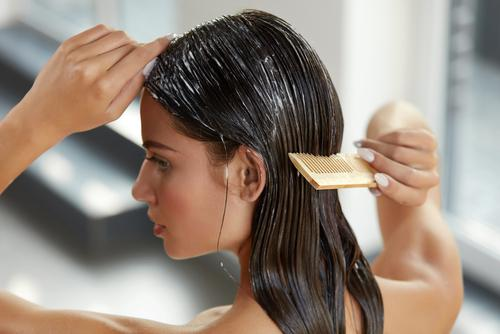 woman applying conditioner