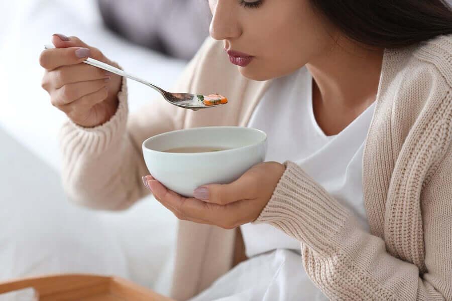 A woman having a bowl of soup.