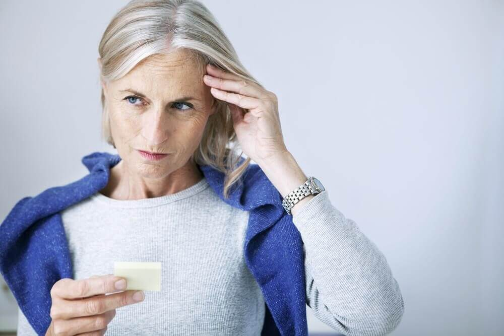 old woman trying to remember something