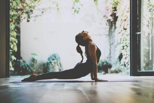 woman doing sun salutation yoga