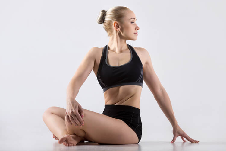 A woman doing a yoga stretch.