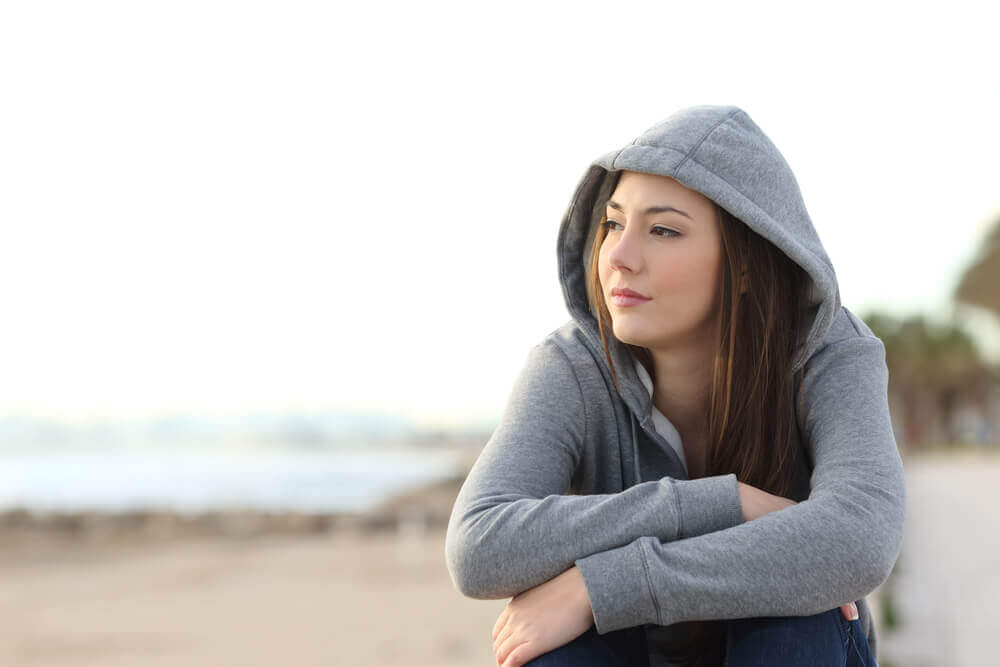A girl sulking because of mood swings during adolescence.