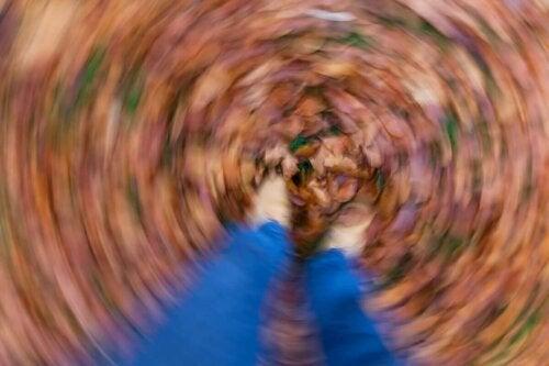 A person with vertigo looking at the ground.