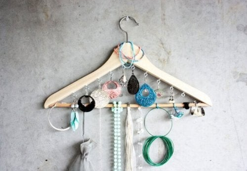 A coat hanger with many accessories hanging on it