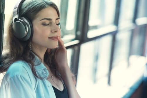 A woman listening to music which is important to get enough rest.
