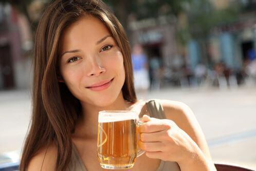 A woman enjoying a beer