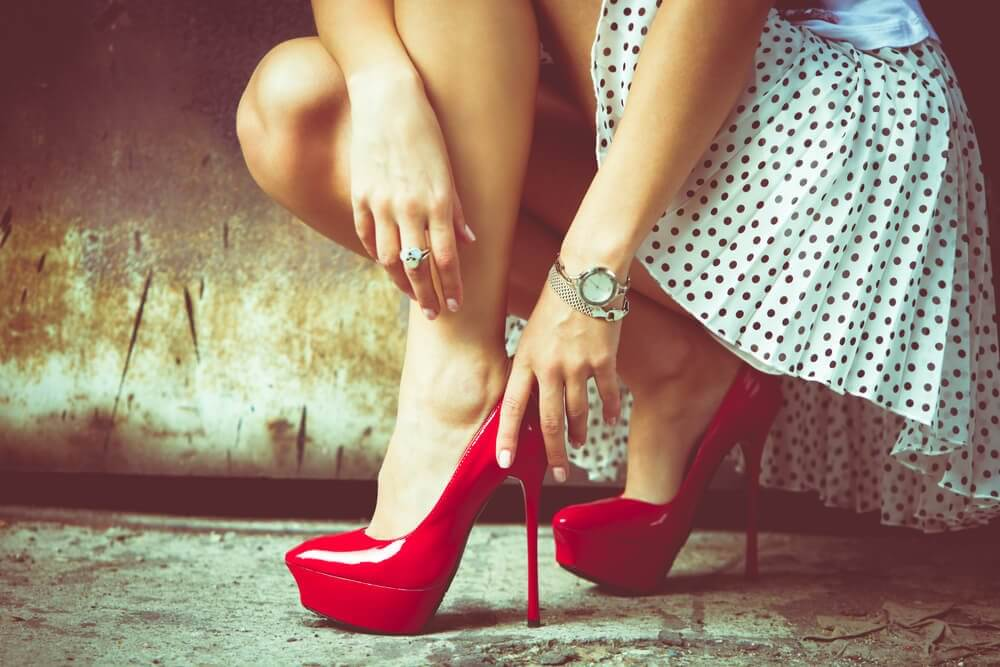 Woman Putting on High Heels