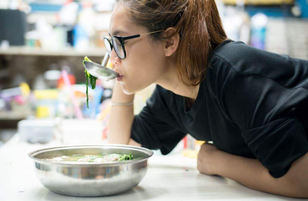 Woman drinking cabbage soup