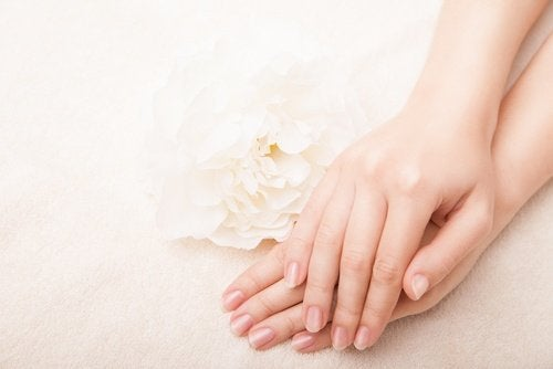 A woman using homemade hand creams