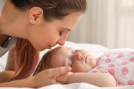 Mom looking at her sleeping baby.