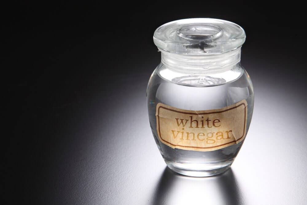 A jar of white vinegar.