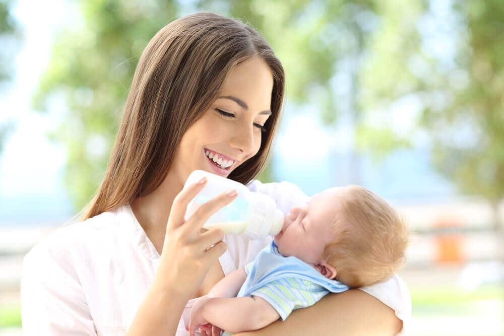 Woman bottle feeding her baby