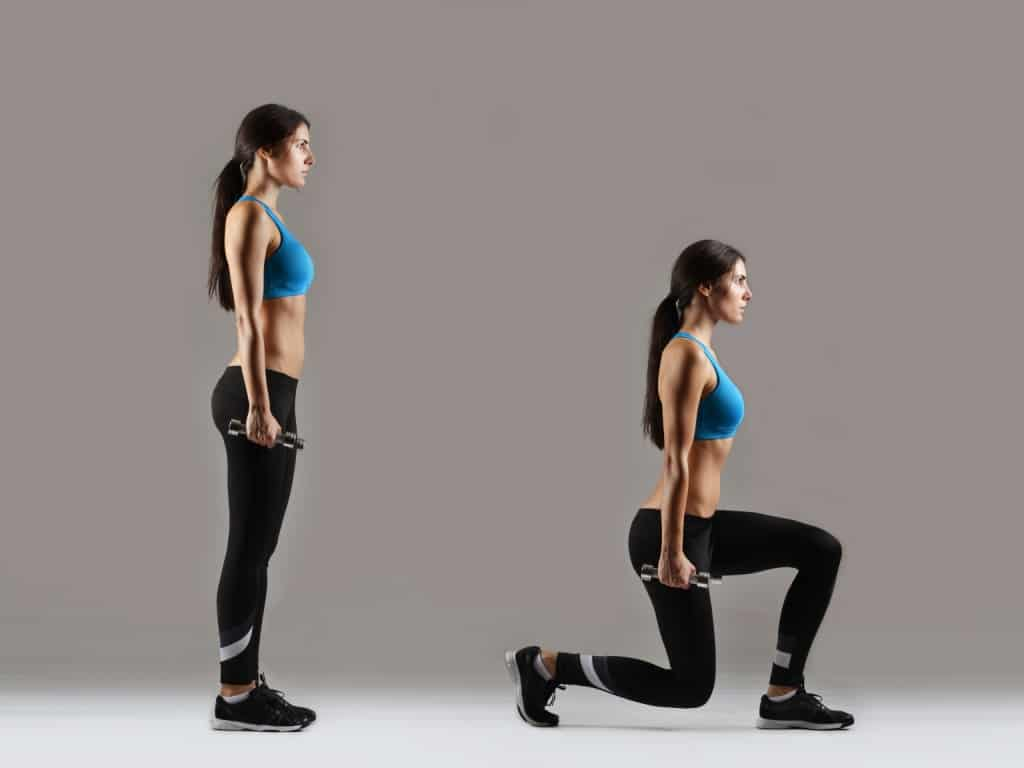 Woman doing lunges with weights