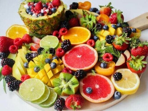 A bunch of fruit on a plate.