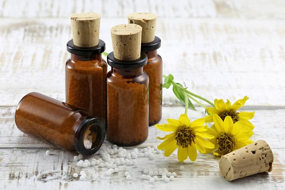 Bottles of arnica oil to treat lower back pain