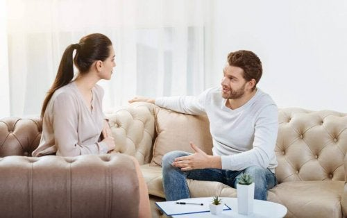 Couple arguing on sofas